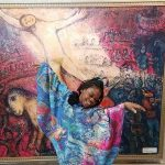 girl dancing in cape in front of Chagall's Circus painting at Waukegan Pop-Up