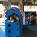 Children posing inside of a structure made from oversized foam construction shapes at Waukegan Pop-Up