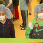 Children wearing masks at the Dr for a Day event