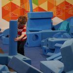 Child playing at the Build it exhibit