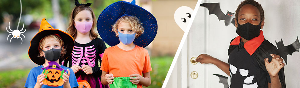 children in halloween costumes while wearing face masks