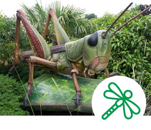 large animatronic grasshopper