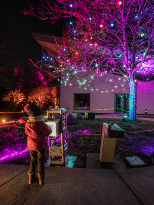 Small child changing the color of lights