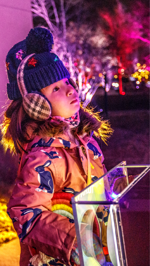 girl turning the handle to change the color of lights